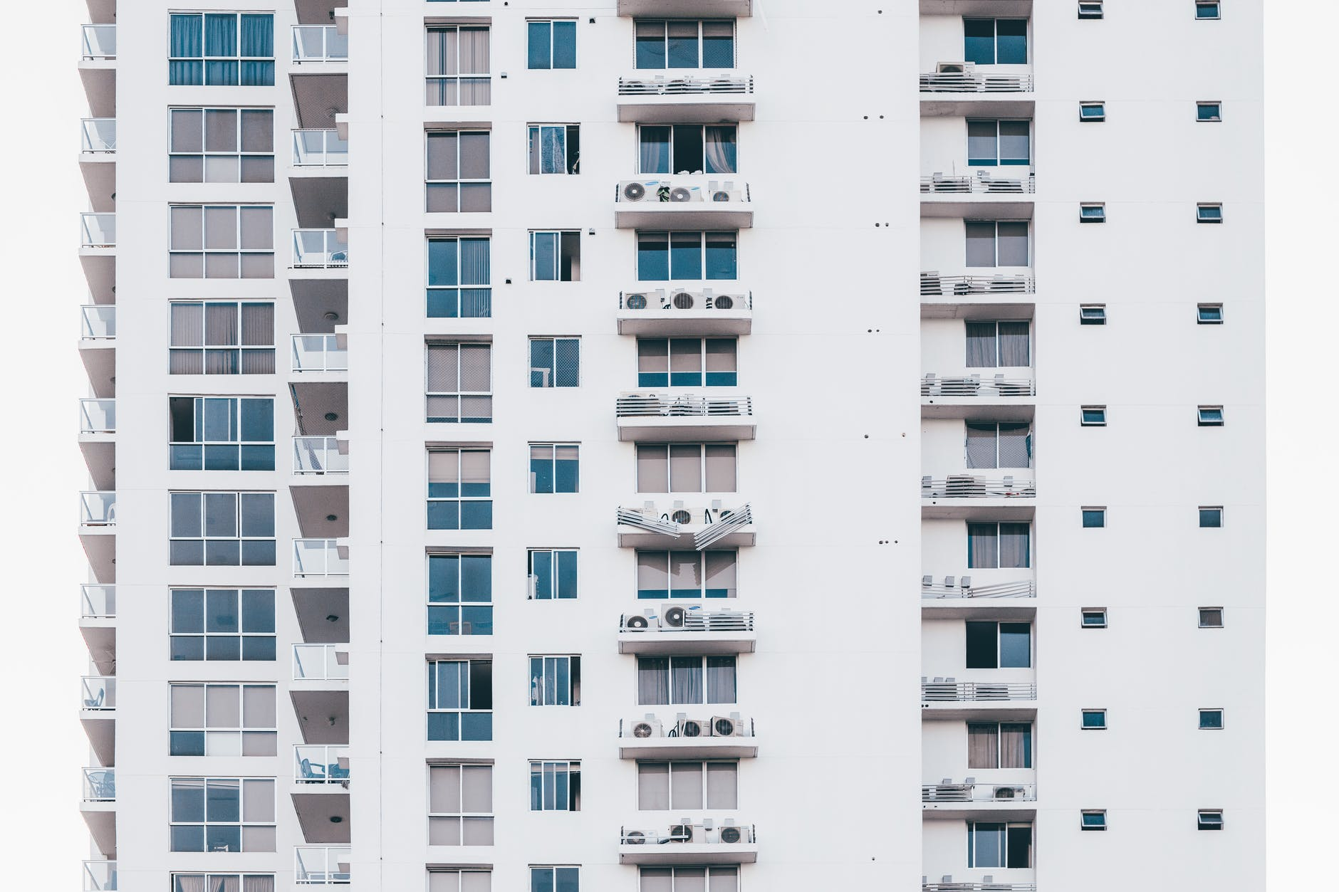 minimalist photography of white and gray condominium